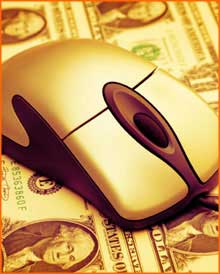 Gold computer mouse on a sheet of one dollar bills.