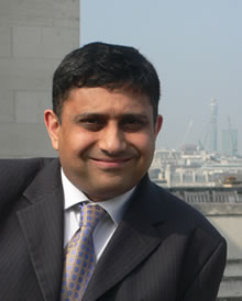 Photo of Sanjay Morzaria with the London skyline in the background